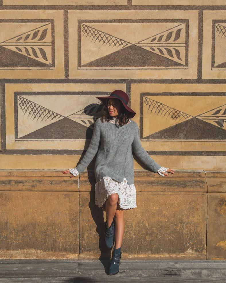 girl in front of wall near Schwarzenbersky Palace in Prague