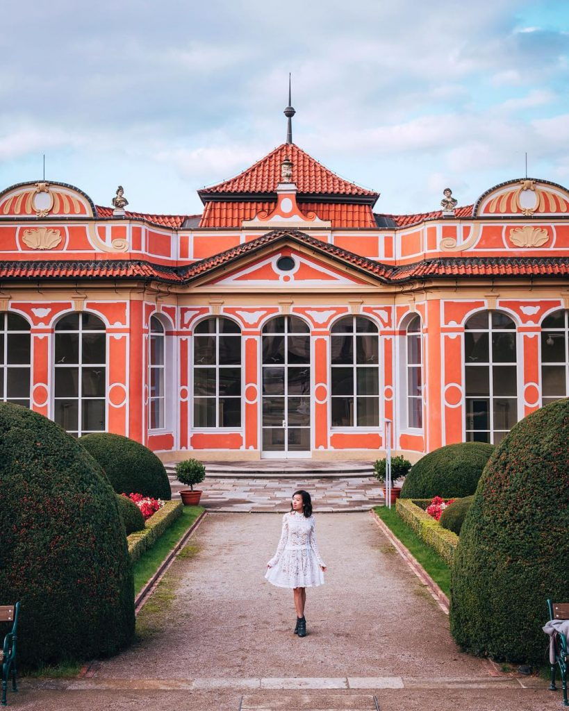 photo of girl in front of Cernisky Palace Gardens in prague