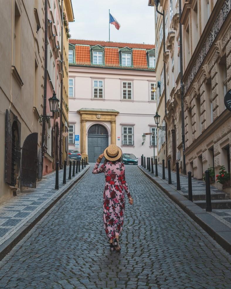 photo of girl on Nerudova Street during Sunrise