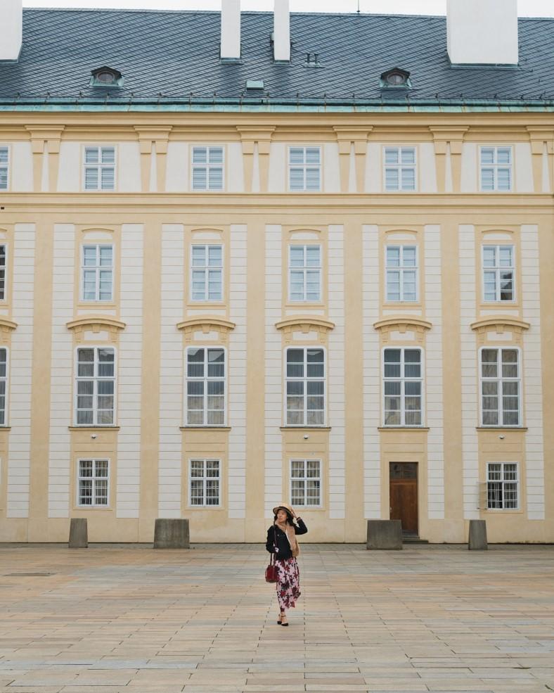 girl in courtyard near Prague Castle