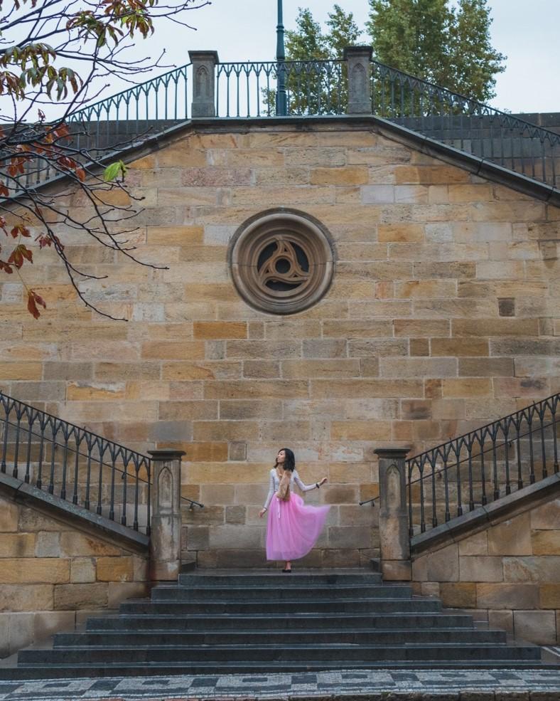 girl on stairs near kampa island in prague