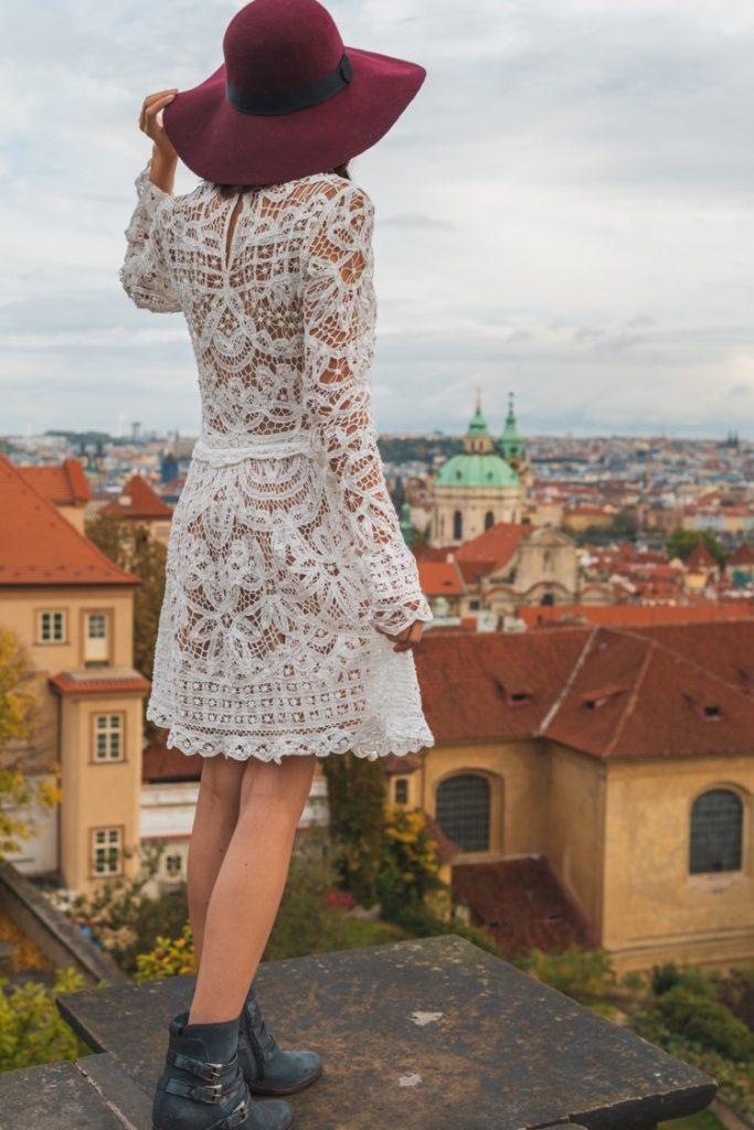 girl on ledge at Starbucks Prague castle