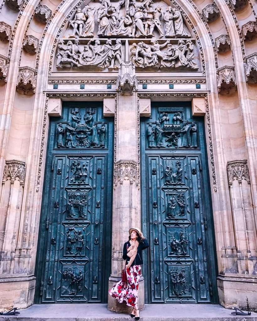 girl in front of st. vitus cathedral door
