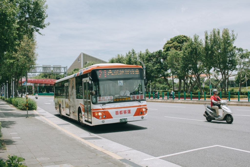 Bus driving along the road in Taipei - witandfolly.co