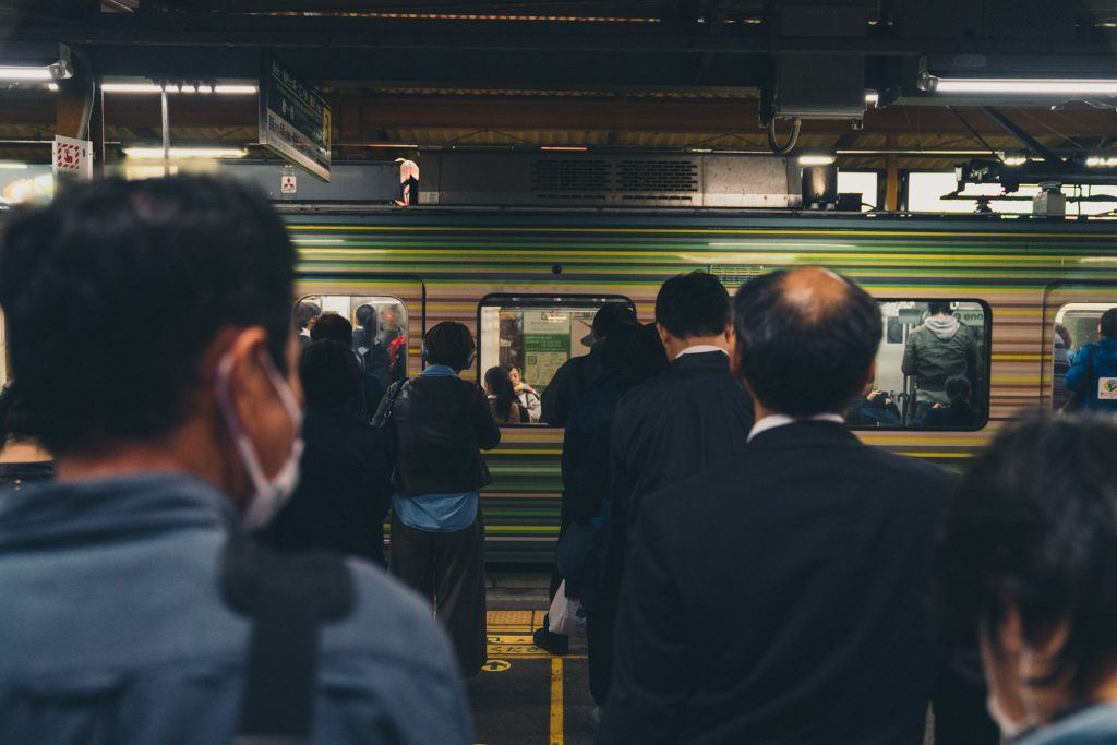 image of japanese workers in line for train