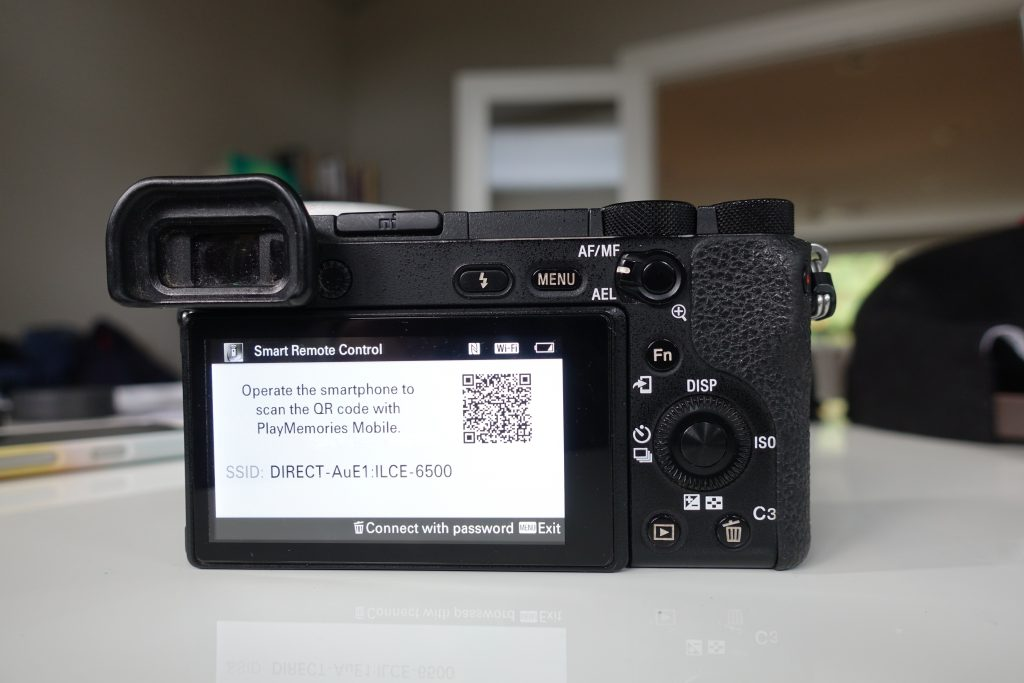 screen showing qr code to scan for smart remote control app on sony