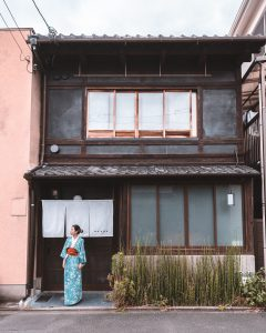 woman standing in front of building in kyoto