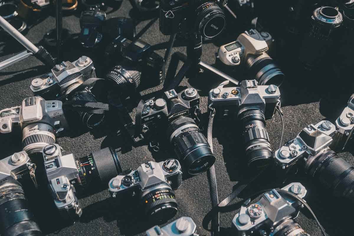 image of many film cameras on a surface