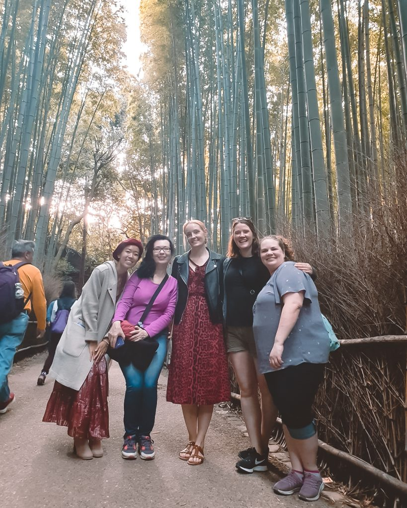 women smiling in bamboo grove