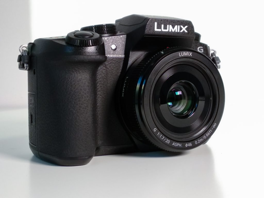 photo of black camera against white background