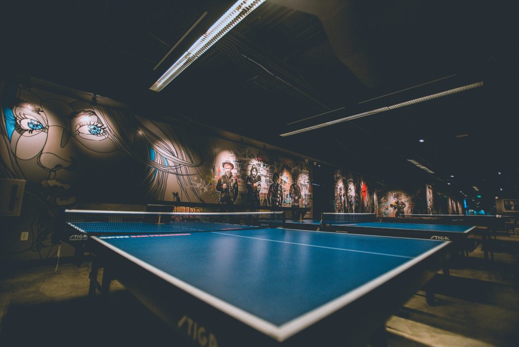 photo of empty ping pong tables
