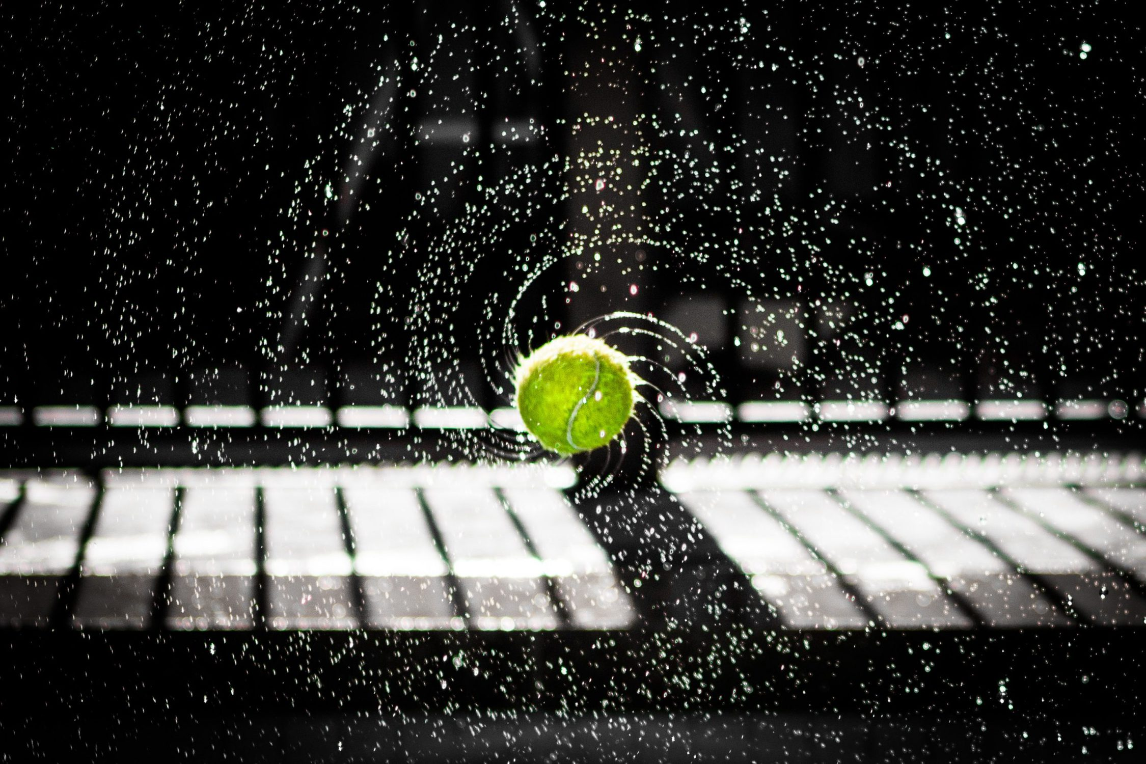 photo of tennis ball spinning with water