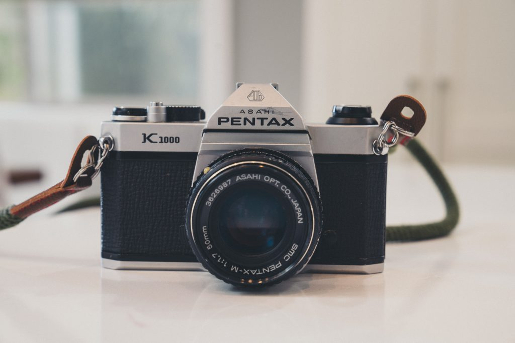 image of pentax k1000 film camera on white counter