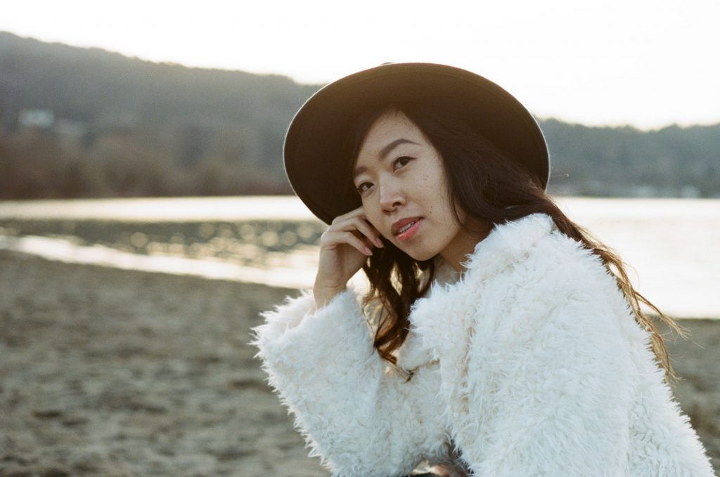 image of girl in hat in white jacket