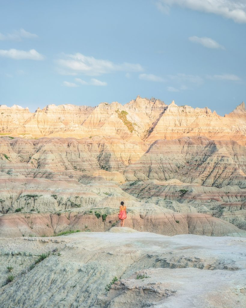 image of girl in front of mountains in badlands national park
