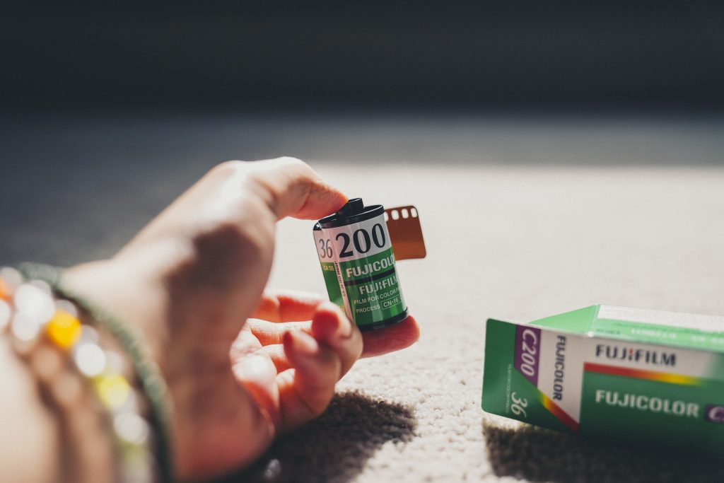 photo of fujifilm c200 film canister held in hand