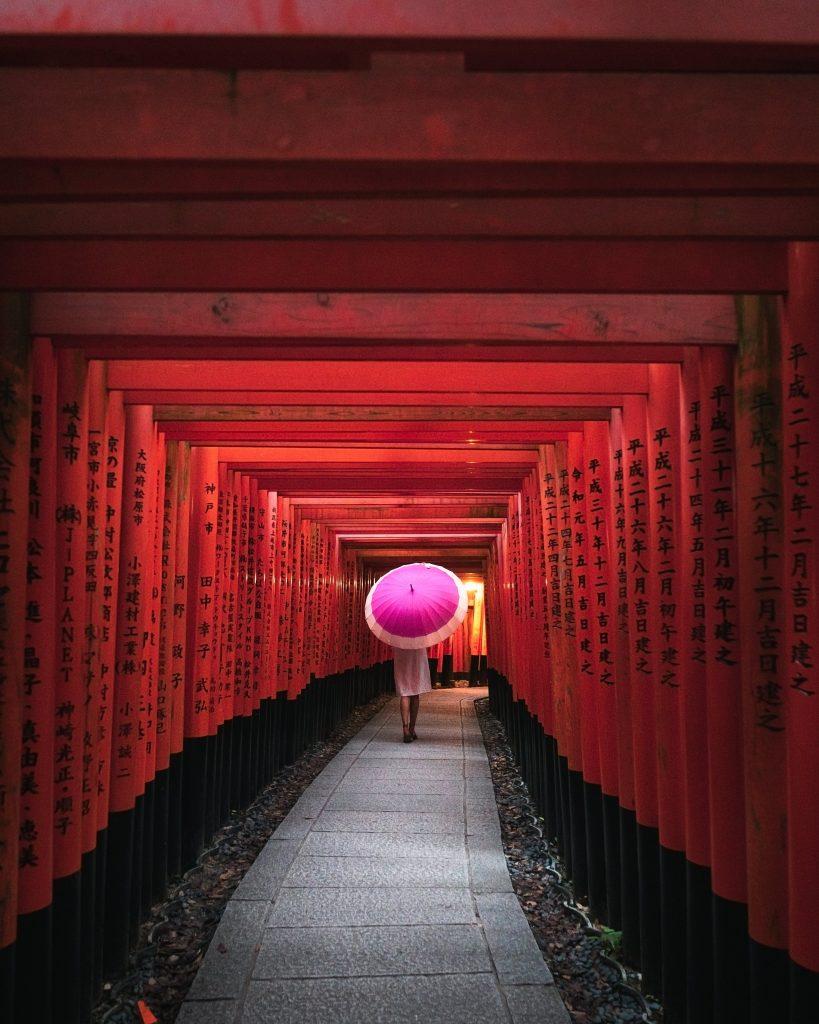image of girl walking through a shrine
