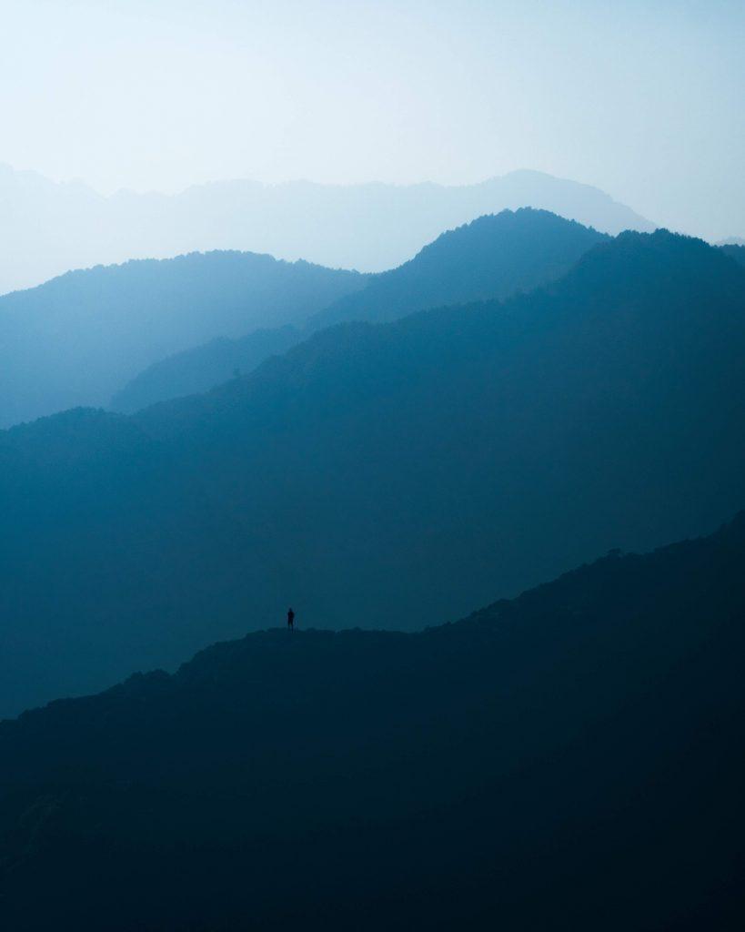 image of person on mountain ridge