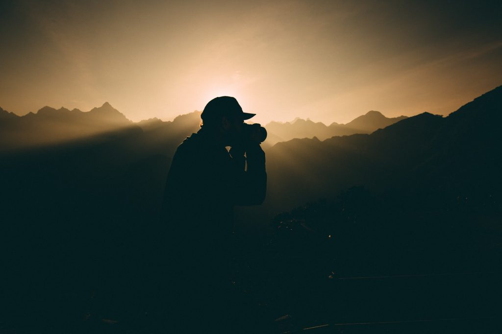 silhouette of guy with camera