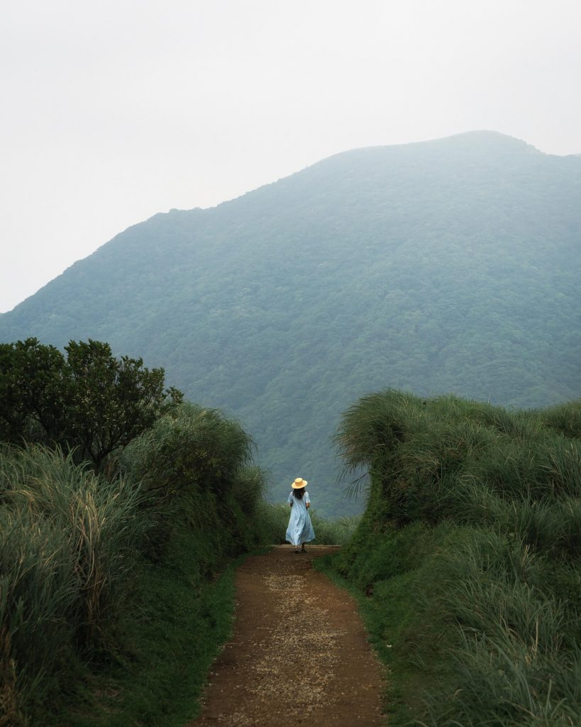 image of girl on hiking path in the mountains