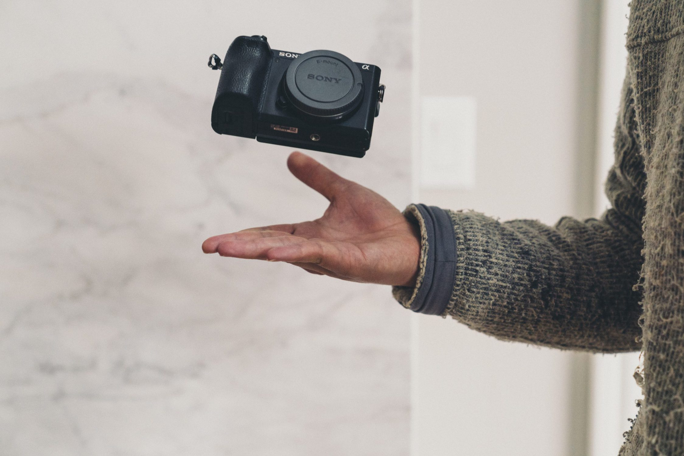 image of camera thrown up with a white background