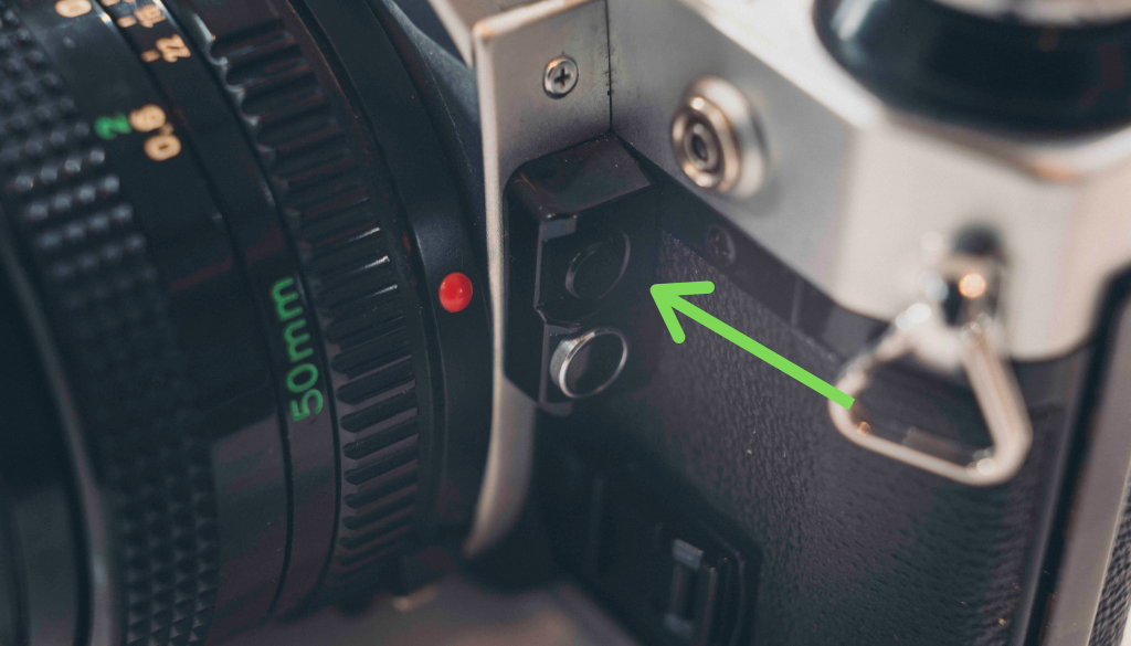 image of arrow pointing to camera button