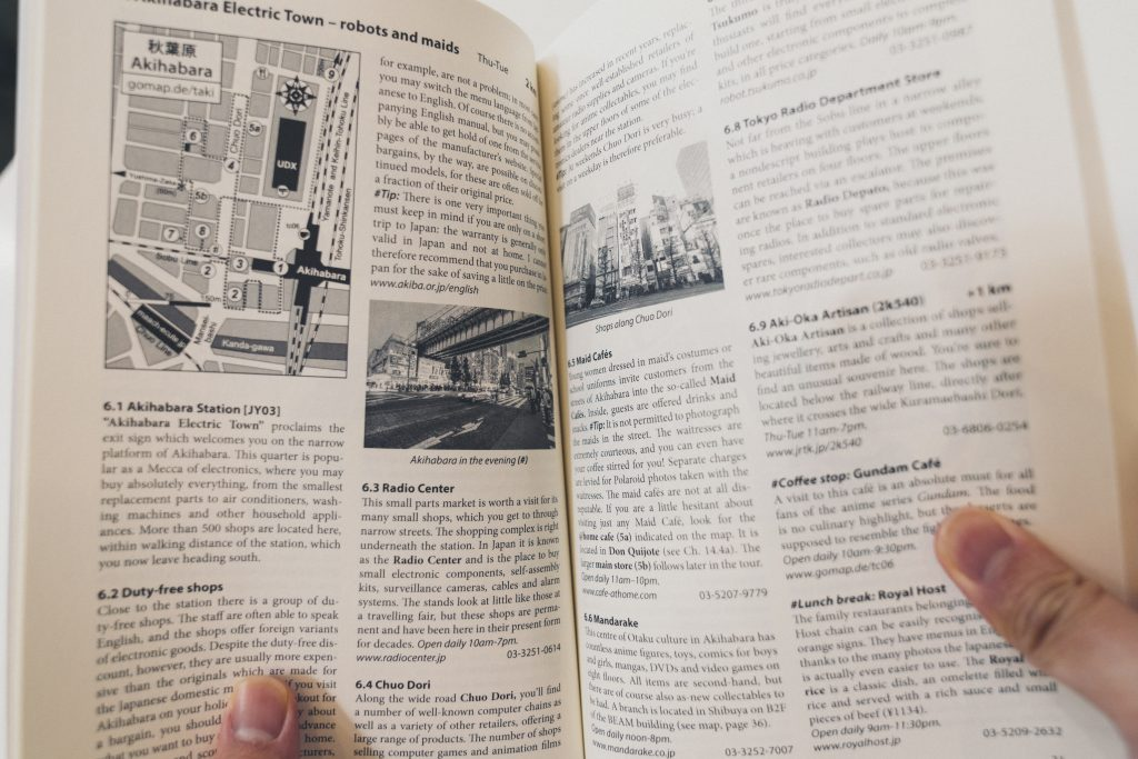 up close image of a book showing walking tours to do in japan