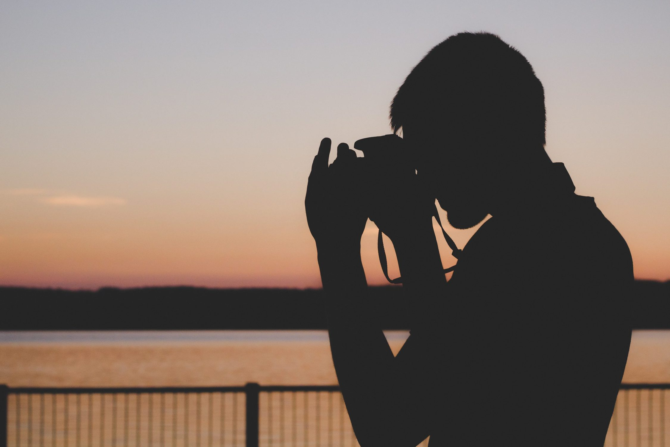 image of silhouette of person using camera