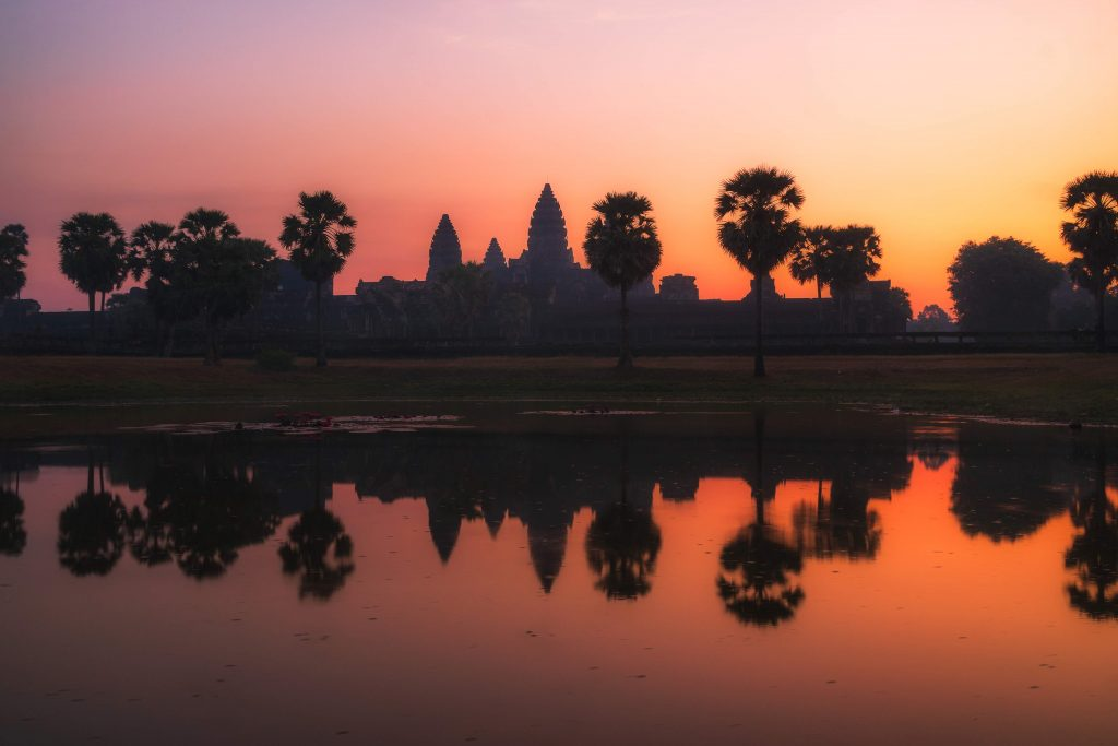 image of angkor wat at sunrise with a reflection in water