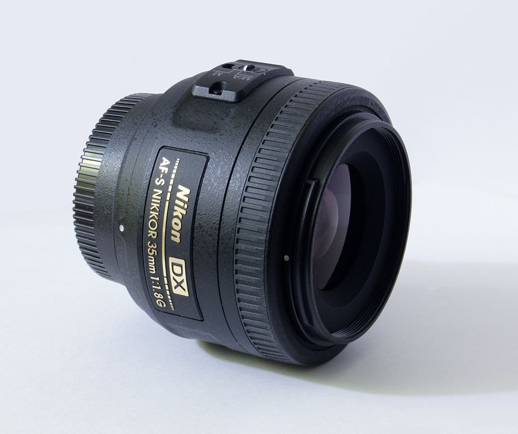image of nikon 35mm 1.8 against a white background
