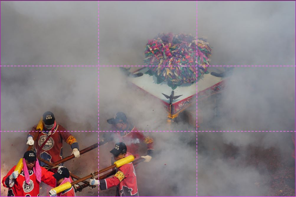image of pilgrims carrying a palanquin with firework smoke everywhere. rule of thirds grid overlayed.