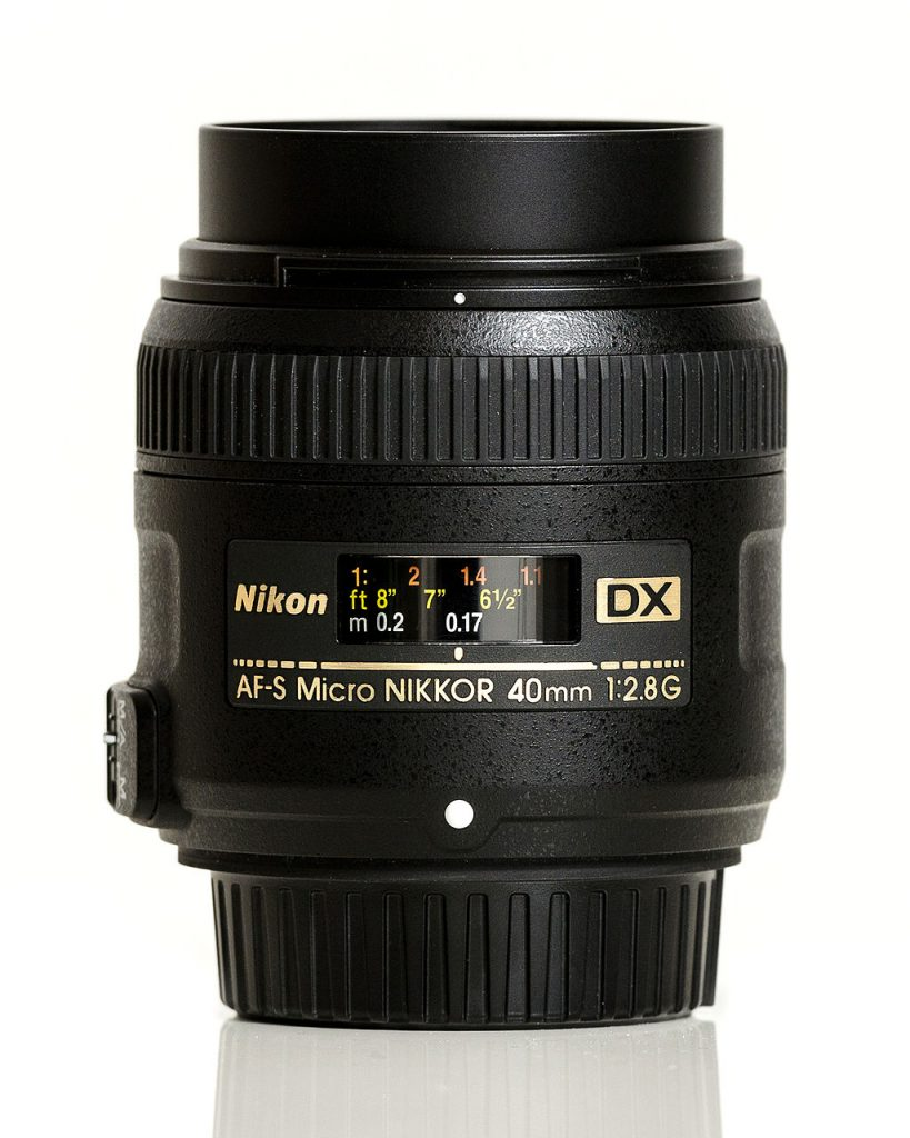 image of 40mm f2.8 in front of white background