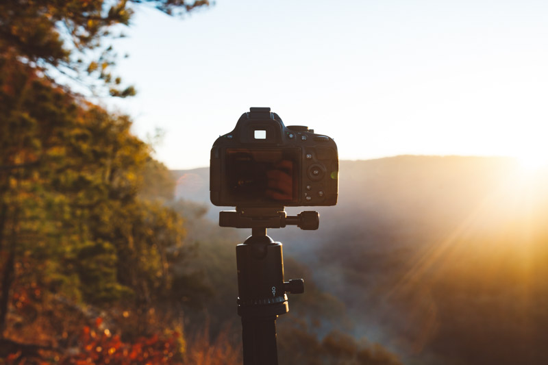 image of camera on a tripod at sunset