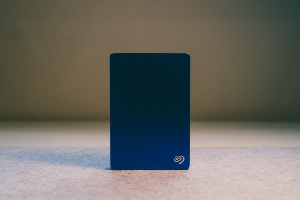 image of blue seagate hard drive standing up