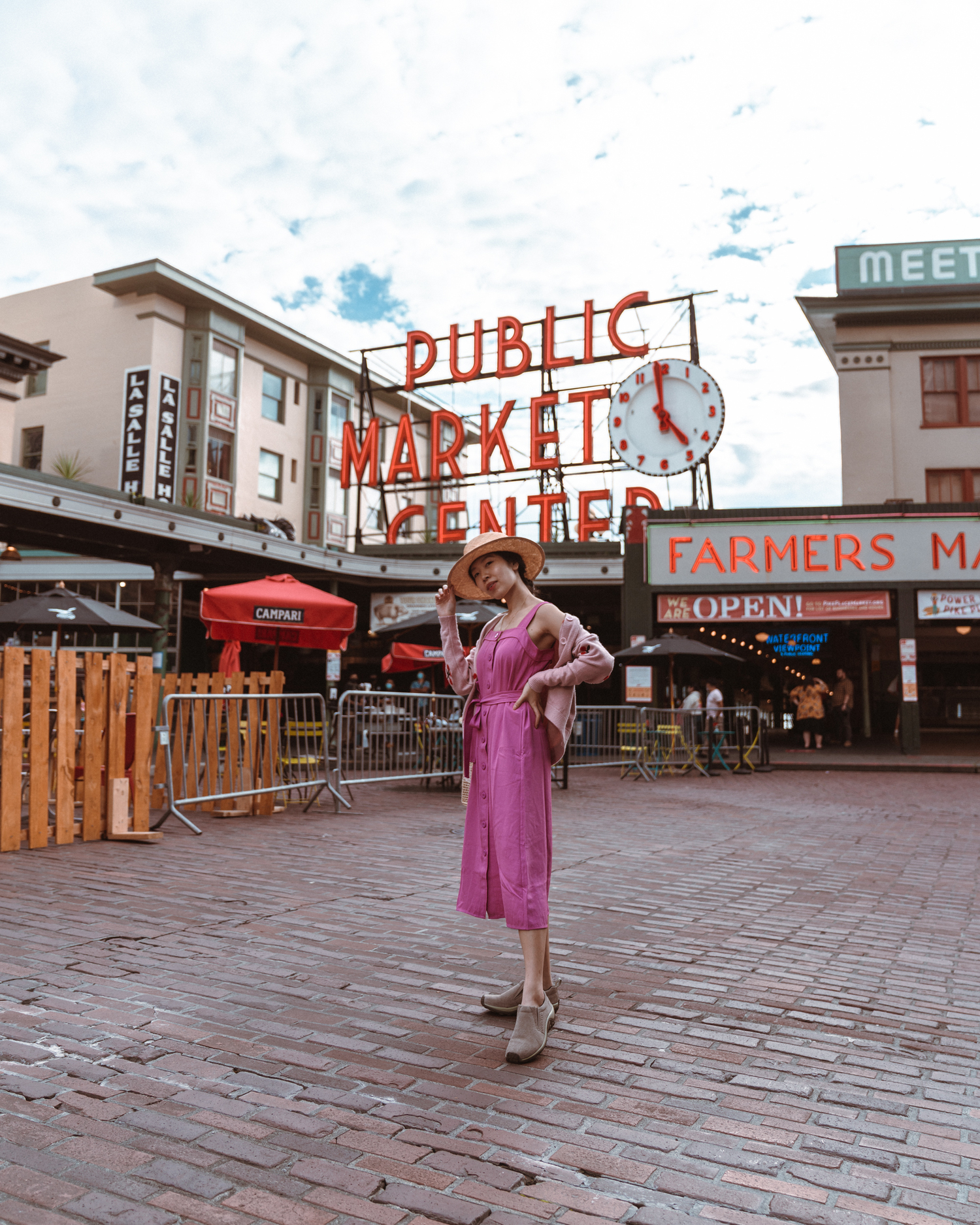 Girl in front of Pike Place Market sign