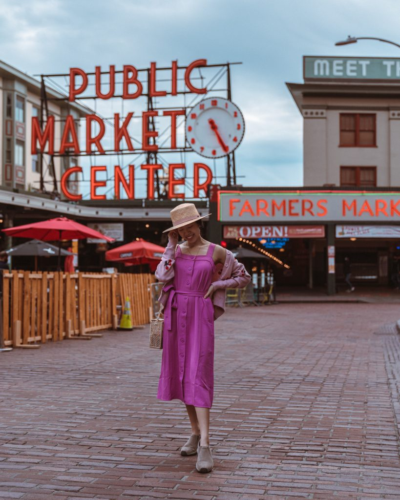 Girl in front of Pike Place Market sign in Seattle