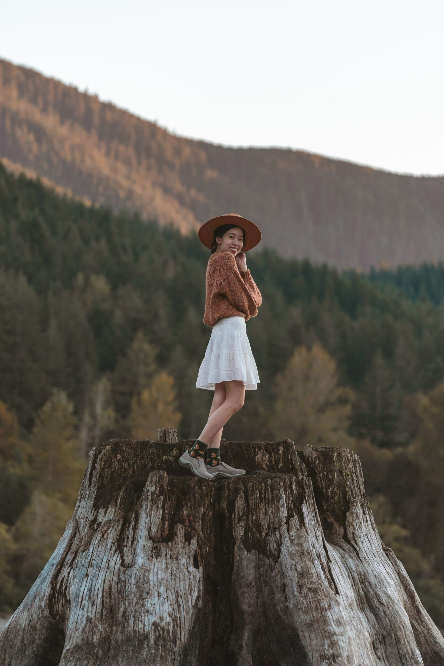 girl standing on tree stump at rattlesnake lake