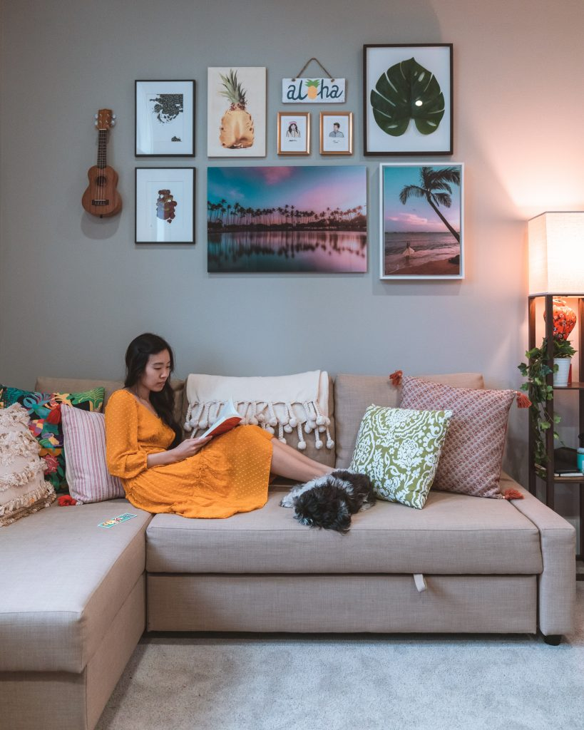 image of girl reading with dog on couch