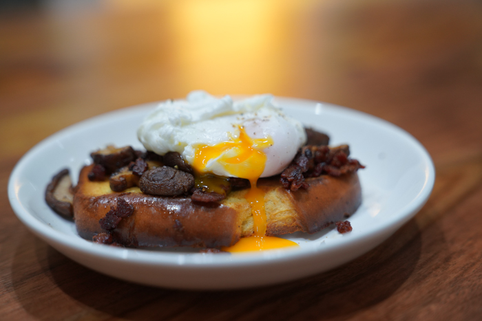 image of poached egg over mushrooms on toast