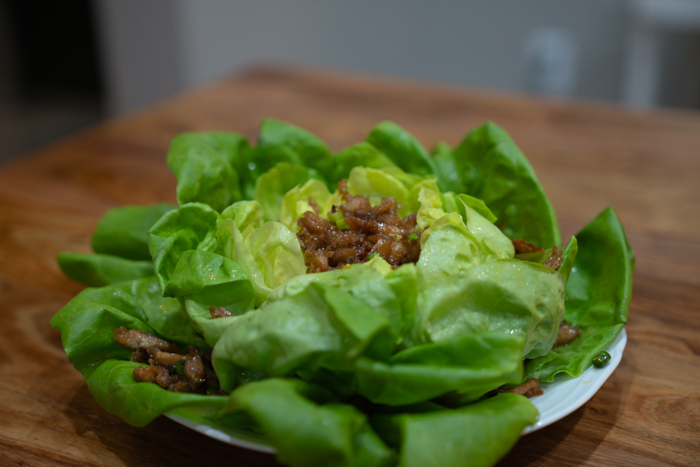 image of salad with fried chicken on it