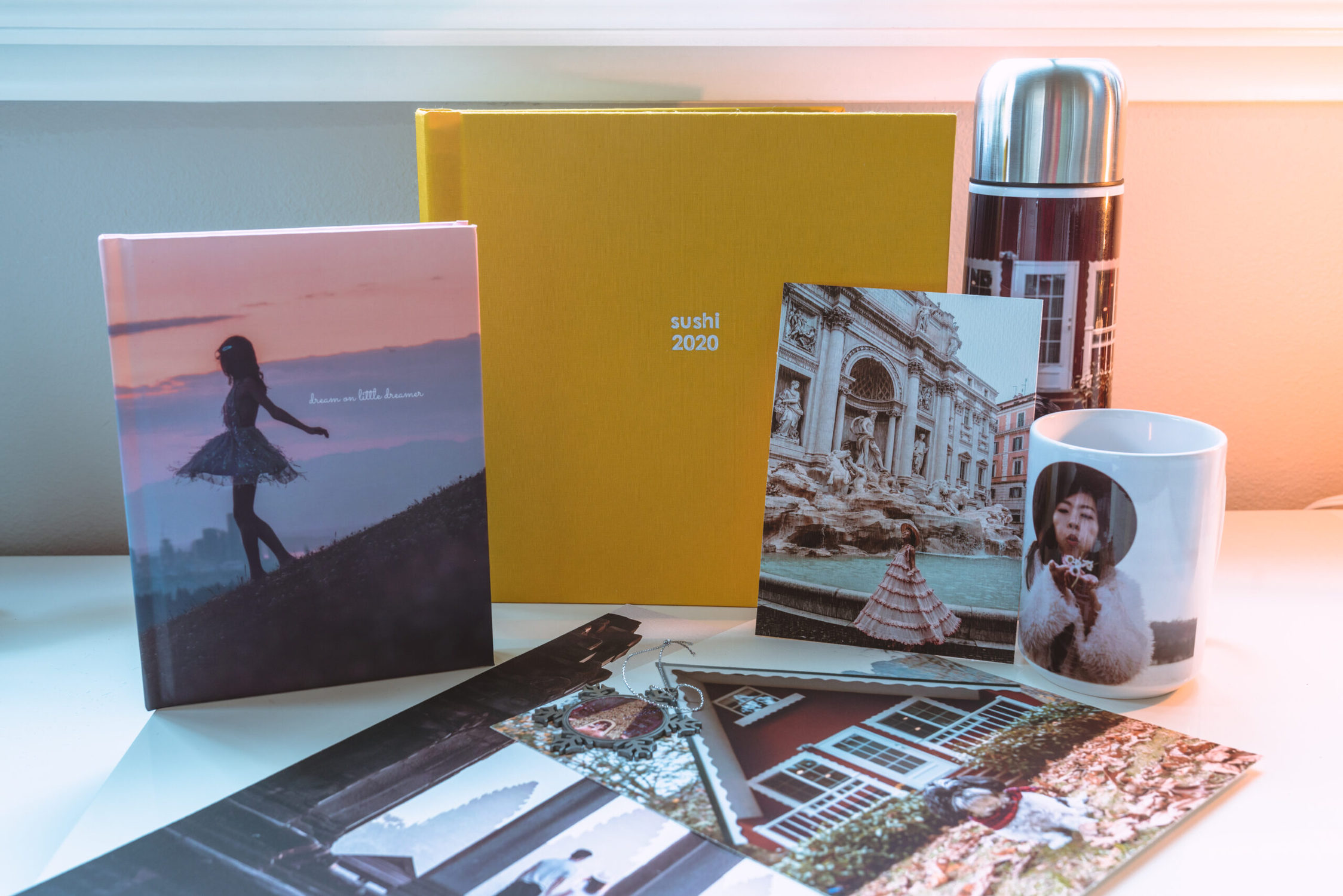 Image of different products with photos on them including a photo book, prints, journal and mug