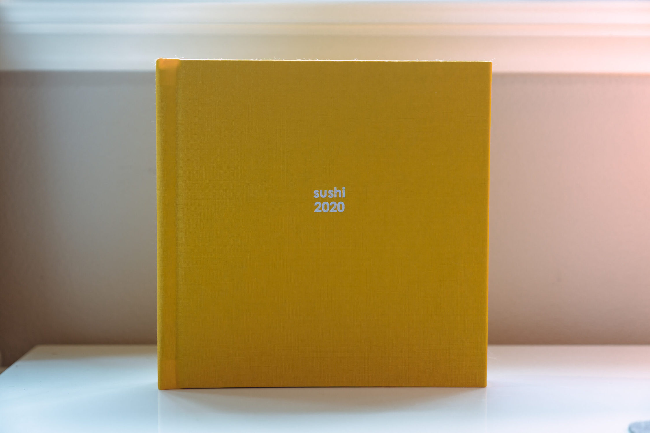 Yellow fabric photo book by Printique
