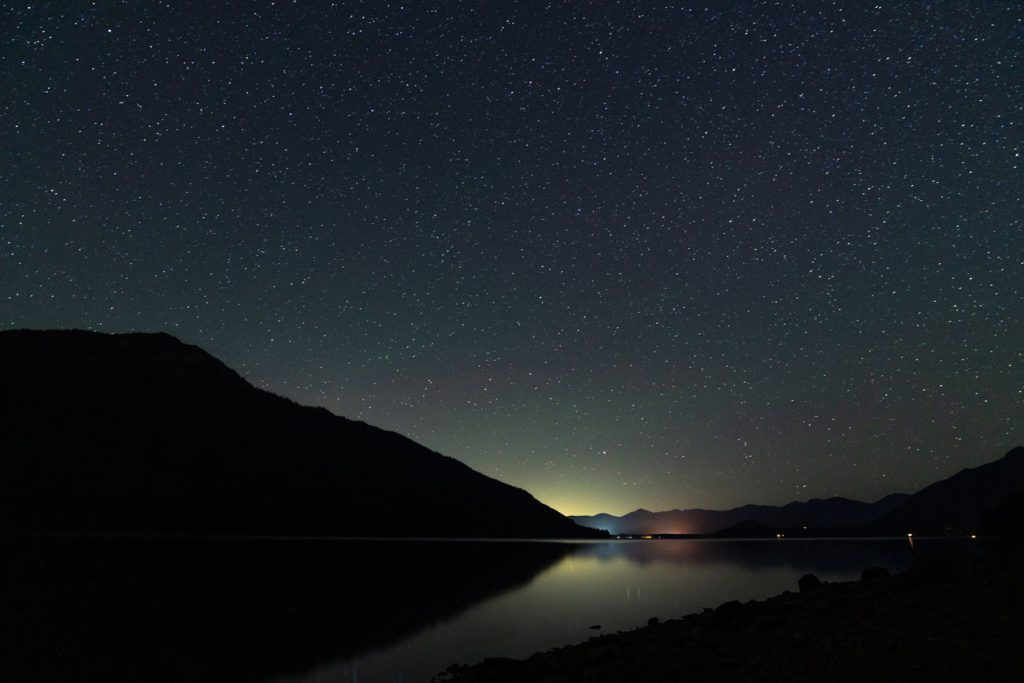 image of night sky with stars over a lake