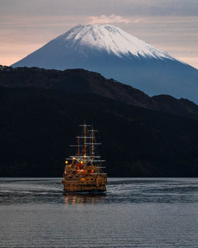 image of a pirate ship on lake in front of mount fuji