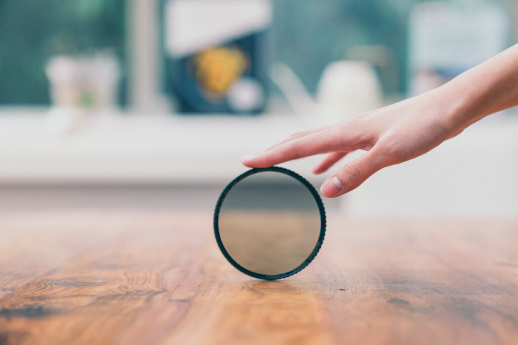 image of filter on a wooden table in front of window