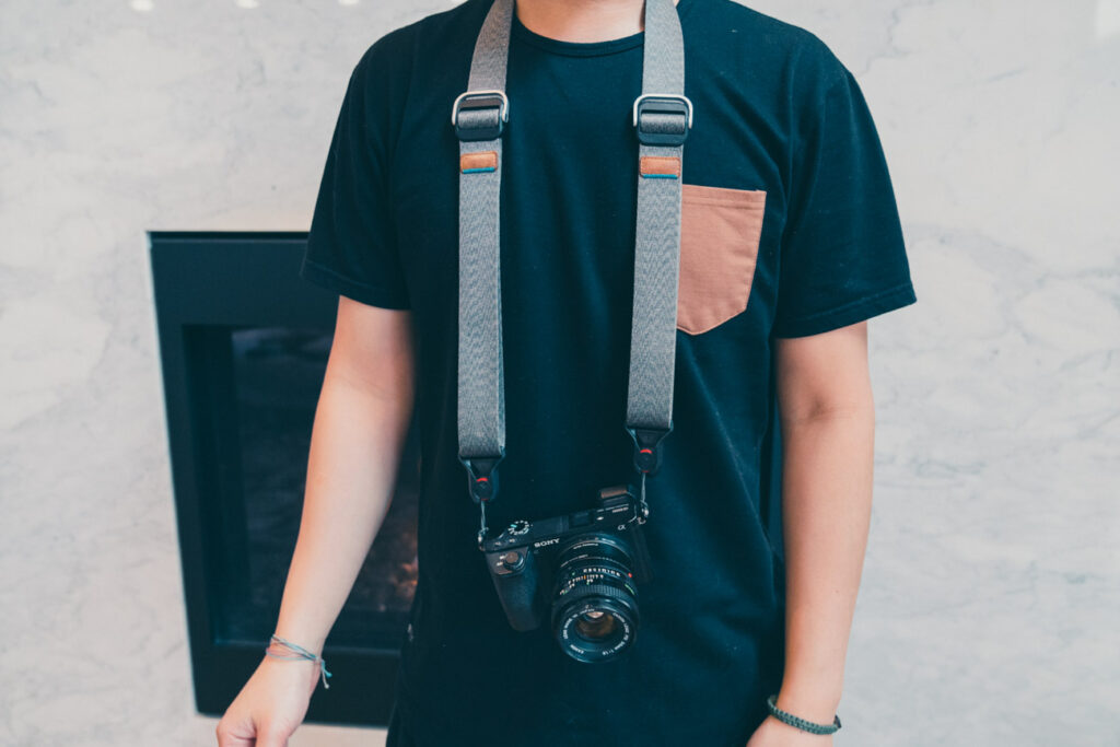 image of a camera hanging on a strap from person