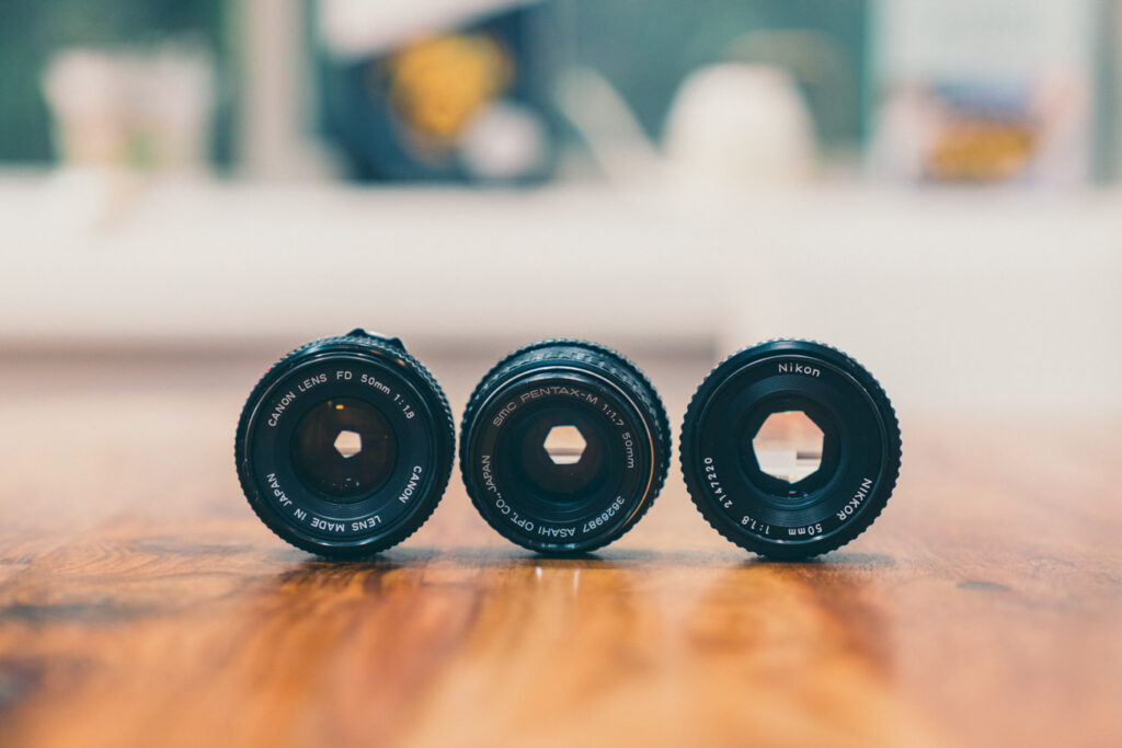 image of 3 vintage lenses sitting next to each other