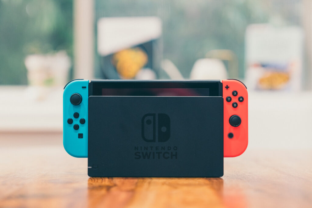 image of nintendo switch on a wooden table