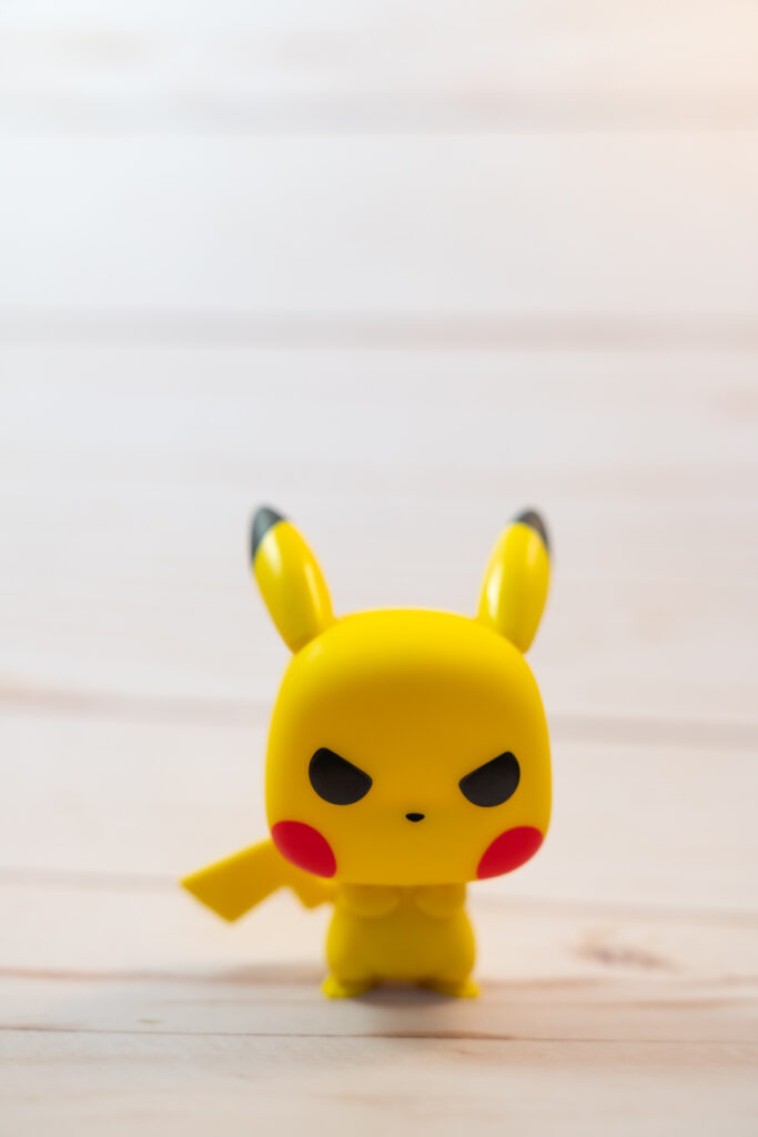 image of pikachu standing against a white backdrop