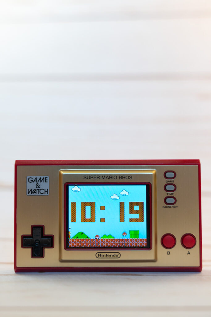 image of nintendo game and watch in front of white background
